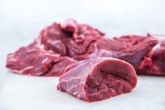 白色的背景接近的肉猪肉 库存照片