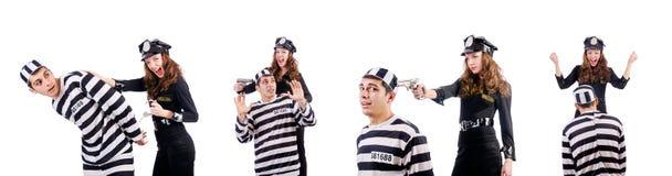 白色的警察和监狱囚犯 免版税库存照片