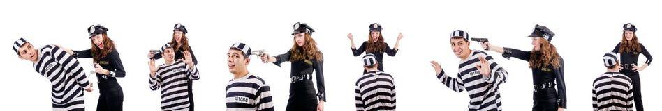 白色的警察和监狱囚犯 免版税图库摄影