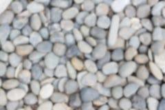 白色石头和小卵石背景图象迷离  库存照片