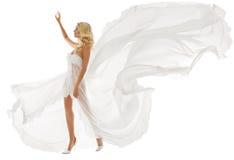 白色礼服的美丽的妇女有飞行织品的 库存图片