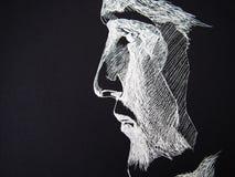 白色笔手图画人面孔 免版税库存照片
