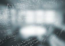 白色算术乱画和模糊的灰色办公室 库存照片