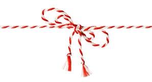 白色红色绳索弓,麻线丝带白色 库存照片