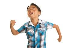 白色背景和激动的表示的逗人喜爱的菲律宾男孩 免版税库存图片