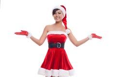 白色背景的一个愉快的圣诞节亚裔式样女孩 库存图片