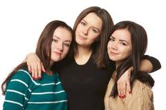 白色背景的三个女朋友 免版税库存照片