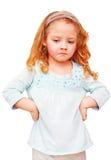 白色背景的不快乐的小女孩 免版税库存照片