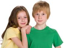白色背景的两个孩子 库存图片