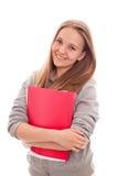 白色背景的微笑的少年女小学生 免版税库存图片