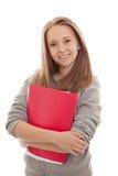 白色背景的微笑的少年女小学生 库存照片