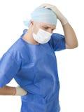 白色背景的担心的医生 免版税库存图片