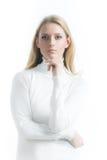 白色背景的白肤金发的女孩在高领衫 图库摄影