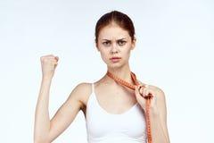 白色背景的美丽的妇女,画象,健身,体育,减肥,饮食 免版税库存图片