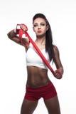 白色背景的美丽的性感的战斗机女孩; 免版税库存照片