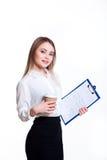 白色背景的年轻可爱的企业女孩与文件夹 库存图片