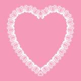 白色花边状的心脏形状框架,华伦泰卡片 免版税库存图片