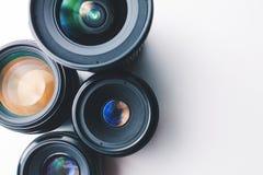 白色表面上的摄象机镜头 图库摄影
