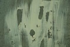 白色被摩擦的油漆污点在绿色墙壁上的 库存照片