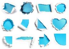 白色被撕毁的纸的汇集有在许多的蓝色背景shap 免版税库存图片