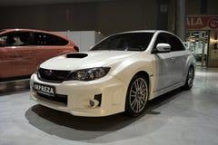 白色调整的汽车:Subaru Impreza 免版税库存照片