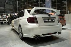 白色调整的汽车:Subaru Impreza 免版税图库摄影
