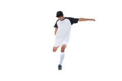 白色踢的足球运动员 免版税图库摄影
