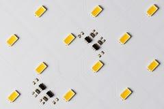 白色铝电路板顶视图有SMD的LEDs和微集成电路 库存图片