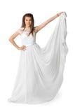 白色长的礼服的女孩在框架看 免版税库存照片