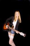 白色长袜戏剧吉他的女孩 库存图片