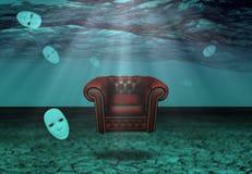 白色面具和扶手椅子在水下的沙漠 免版税库存图片