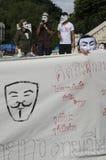 白色面具运动集会 免版税库存照片