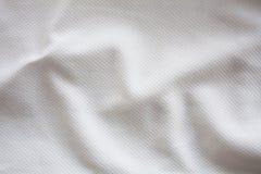 白色织地不很细橄榄球球衣 免版税库存照片
