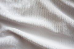 白色织地不很细橄榄球球衣 库存照片