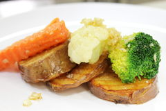 白薯红萝卜油煎了黄油块凯利 库存照片