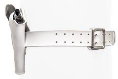 白革两有一杆枪的橛传送带在一个被铸造的手枪皮套,克洛 库存照片