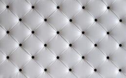白革按钮床头板背景 免版税库存图片