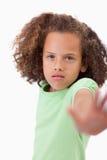 说的女孩的画象中止用她的手 库存照片