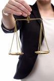 的妇女拿着正义标度  库存图片