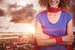 的妇女的画象的综合图象假装是超级英雄 免版税库存照片