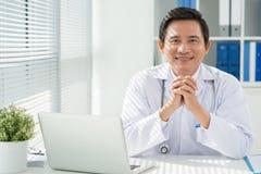 他的工作场所的医生 免版税库存图片