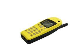 质朴的明亮的黄色减速火箭的手机 免版税库存照片
