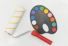 绘的有水彩油漆的路辗和调色板 免版税库存照片