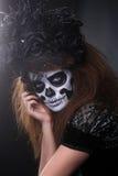 死的概念和题材的美好的创造性的面孔油漆天 库存图片