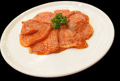 滑的猪肉与在白色盘的调味汁混合了 图库摄影
