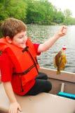 他的第一条鱼 库存图片