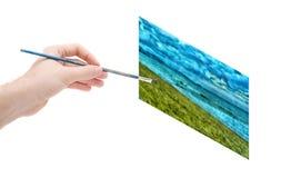 绘画的艺术家的手 免版税库存照片