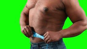 他的评定肌肉腰部的人 影视素材