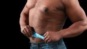 他的评定肌肉腰部的人 股票录像