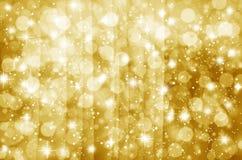 轻的金子和黑色 defocused 库存照片